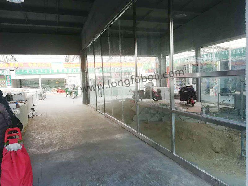 西坝栅便民市场钢化玻璃不锈钢门