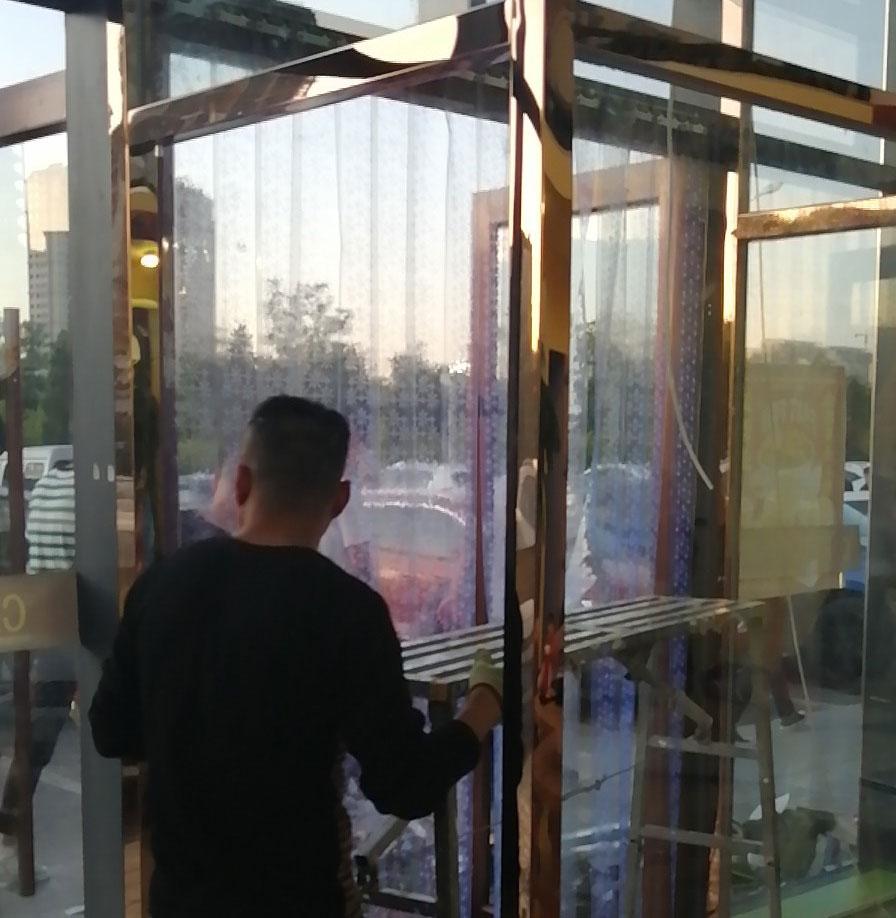 内大北门滨河北路玫瑰金不绣钢玻璃门安装